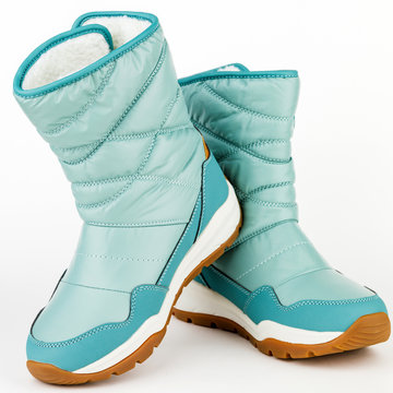 child winter blue boots on a white background
