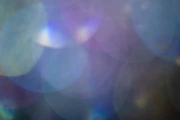 Abstract blurred shiny glitter lamp lights background.