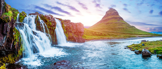 Poster de jardin Cascades Beautiful magical scenery with a waterfall Kirkjufell near the volcano in Iceland at sunset. Exotic countries. Amazing places. Popular tourist atraction. (Meditation, antistress - concept).