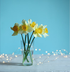 Photo sur Toile Narcisse Easter background with daffodils and eggs,nest,bunny