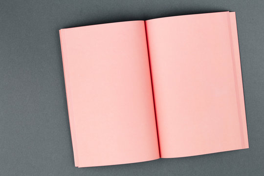 Pink notebook on two-tone gray background