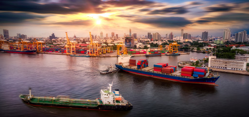 Wall Mural - Aerial view of cargo ship, cargo container in warehouse harbor at thailand, container ship in import export and business logistic with sunset