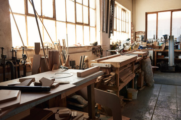 Workbenches inside of a large woodworking shop