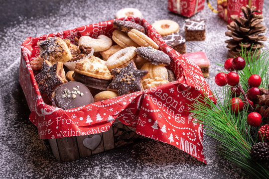 Homemade traditional Christmas cookies on decorated can powdered with icing sugar.