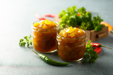 Homemade fruit chutney with pepper and herbs