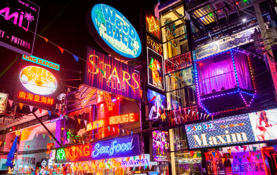 Colorful nigh clubs neon signs on main nightlife street in Pattaya, Thailand, May 2019