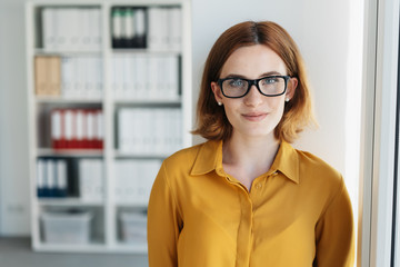 Smiling young businesswoman wearing glasses