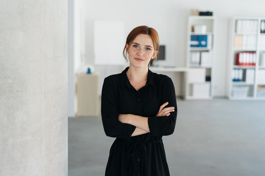Thoughtful confident young businesswoman