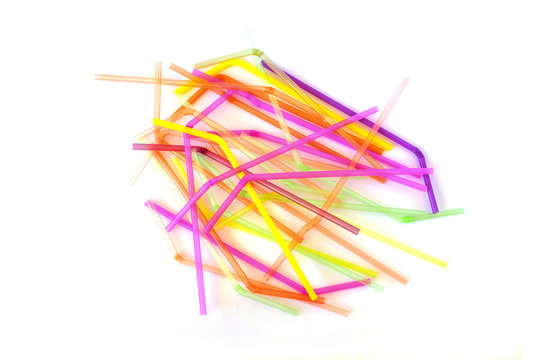 Colorful plastic drinking straws isolated on a white background. Top view.