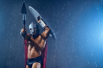 Spartan holding spear and shield.