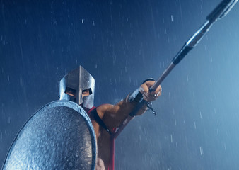 Spartan warrior fighting with spear.