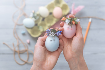 woman makes cute decorative eggs for easter holiday. do-it-yourself easter gifts concept. cute...
