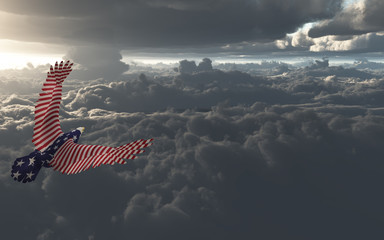 Wall Mural - Eagle in US national colors flies above clouds.