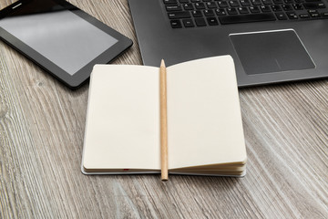 Blank notepad at a working place