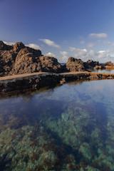 Garachico volcanic natural pools, volcanic rocks in Atlantic ocean, long exposure, Tenerife, Canary islands, Spain