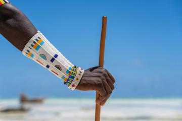 Stores photo Zanzibar Tribal masai hand with a colorfull bracelet, closeup. Zanzibar, Tanzania, Africa