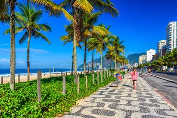 Fotobehang - Ipanema beach with mosaic of sidewalk in Rio de Janeiro, Brazil.