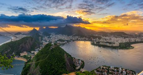 Fotobehang - Sunset view of Copacabana, Corcovado, Flamengo, Botafogo and Centro in Rio de Janeiro, Brazil. Panorama of Rio de Janeiro and Guanabara bay. Skyline of Rio de Janeiro