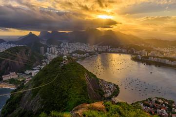 Fototapete - Sunset view of   Corcovado, Urca and Botafogo in Rio de Janeiro, Brazil. Sunset skyline of Rio de Janeiro