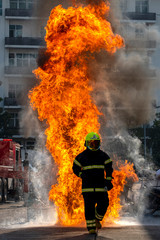 Foto op Canvas Vuur The Firefighters demonstrating fire fighting.