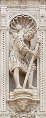 ACIREALE, ITALY - APRIL 11, 2018: The statue of St. Cristopher on the facade of Basilica Collegiata di San Sebastiano designed by Angelo Bellofiore 18. cent.
