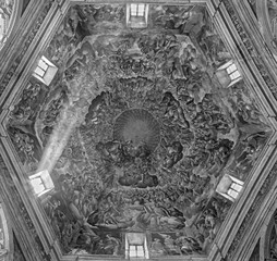 PARMA, ITALY - APRIL 16, 2018: The Holy Trinity and saints in the glory in cupola of Chiesa di Santa Maria del Quartiere by P. A. Bernabei, his brother Alessandro and G. M. Conti dela Camera (1620).
