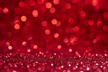 Red blurred abstract shiny valentines day background with bokeh effect, festive glitter sparkles