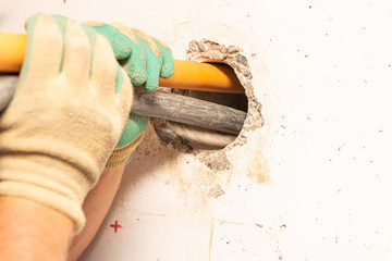 Wall breakthrough through a core hole by professionals for the installation of a gas connection and for a fibre optic cable