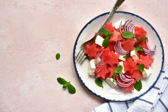 Watermelon salad with feta cheese, red onion and mint. Top view with copy space.