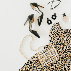 Türaufkleber Leopard Modern fashion collage with female clothes and accessories. Leopard print dress, high-heel shoes, earrings, glasses, purse, perfume on white background. Flat lay, top view.