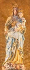 MENAGGIO, ITALY - MAY 8, 2015: The carved polychrome statue of Madonna church chiesa di Santo Stefano by Luigi Tagliaferri (1841-1927).