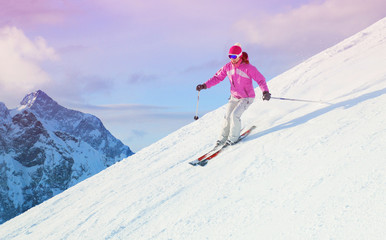 woman skiing  in the mountains