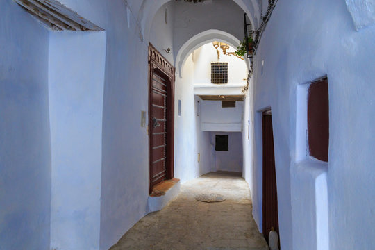View of the old walls of Tetouan Medina quarter in Northern Morocco. A medina is typically walled, with many narrow and maze-like streets and often contain historical houses, palaces, places.