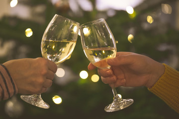 Two glasses of wine toasting during celebration