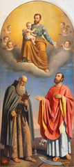 MALCESINE, ITALY - JUNE 13, 2019: The painting of St. Joseph, St. Anthony the Abbot and St. Valentine in church Chiesa di Santo Stefano by Angelo Recchia (1862).