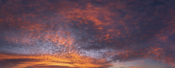 Fototapeta panorama of cloudscape at sunset with red clouds on sky