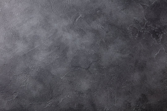 Natural black slate stone background pattern with high resolution. Top view. Copy space.
