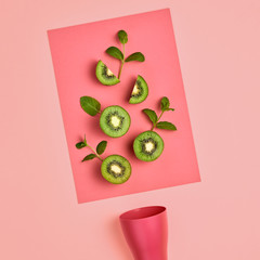 Kiwi Fresh Fruit with Mint leaves. Vegan healthy Organic food Concept. creative green layout. Flat lay. Trendy fashion Style. Minimal Art. Hot Summer Vibes. Bright Pink Color.