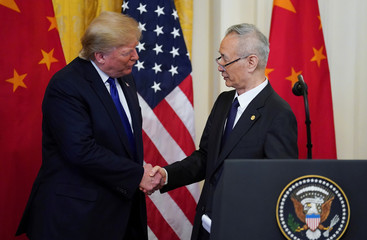 U.S. President Donald Trump shakes hands with Chinese Vice Premier Liu He during U.S.-China trade signing ceremony at the White House in Washington