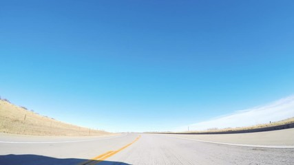 Wall Mural - POV view. Driving West on highway 470 in the Winter.
