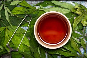 Marijuana herbal tea on cannabis leaves