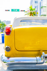 Tail Light of a Yellow Classic American Car in South Beach, Miami, Florida.