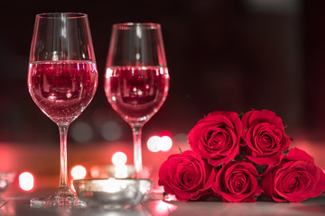 Wall Mural - Wine and roses on table surrounded by candles