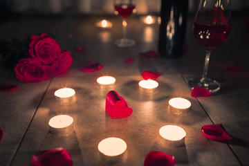 Wall Mural - Romantic valentines date surprise with heart, candles, roses, and wine.