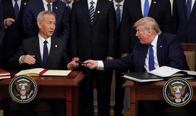 """U.S. President Donald Trump and Chinese Vice Premier Liu He sign """"phase one"""" of the U.S.-China trade agreement in Washington"""