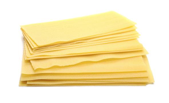 Uncooked Italian pasta lasagne isolated on white background