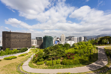 Fotobehang Seoel Viwe of the Seoul historic fortress wall in the Namsan park in Seoul downtown district in South Korea capital city on a sunny summer day