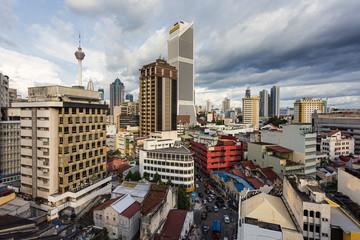 Poster Kuala Lumpur Aerial view of the Kuala Lumpur downtown district in Kuala Lumpur, Malaysia capital city with a dramatic sky