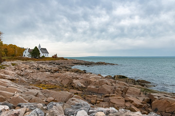 Canada, a small church on the shore of the Saint-Laurent, beautiful bay
