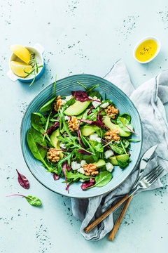 Fresh colorful spring salad - avocado, walnuts and feta cheese
